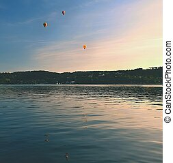 Colorful hot air balloon is flying at sunset. Brno Dam -...