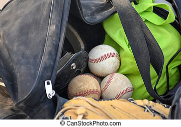 baseballs in duffel bag - baseballs and sports glove in...