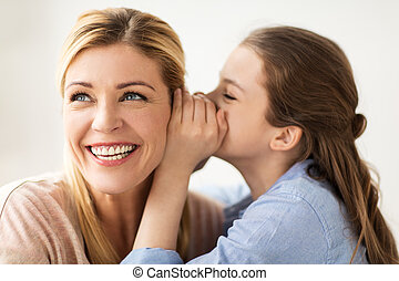 happy girl whispering secret to her mother - people, trust...