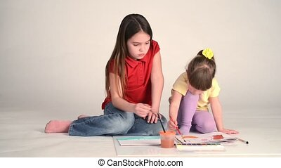 Girl Learning to Draw - Two girls play at home, Children...