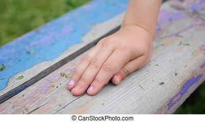 The baby's palm opens and butterflies fly out. Summer Sunny day. Fun and games outdoors