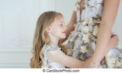 my daughter hugs mother in a long floral