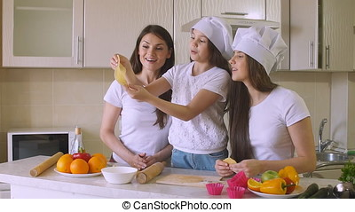 Sisters with Mom Spending Time in Kitchen, Slow Motion.