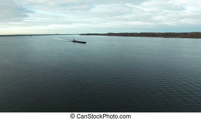 Empty barge is moving up the Volga river