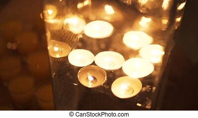 Floating candles glowing in the dark - Close up of several...