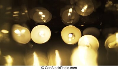 Floating candles glowing in the dark, top view - Top view of...
