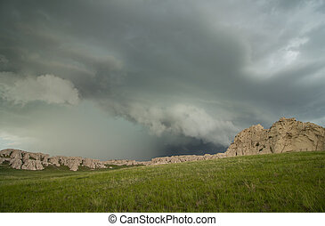 A thunderstorm approaches a rocky hillside in the Great...