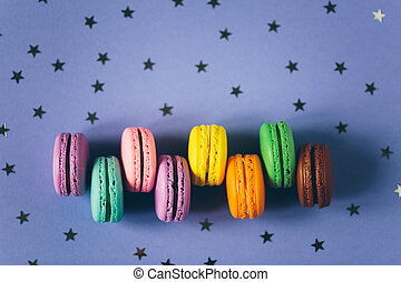 Colorful macaroons on background with stars.