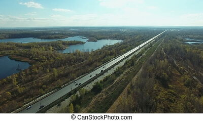 Aerial footage of road and people traveling by cars on a highway