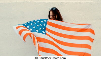 Close Up of Young Ginger Woman Holding Up American Flag...