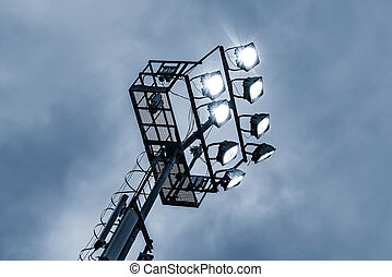 Stadium lights by the sports field. - Stadium lights by the...