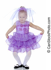 Little girl in purple dress.