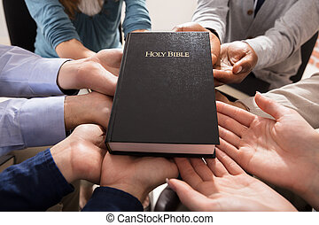 Hands Holding Holy Bible - Holy Bible Over The Hands Of...