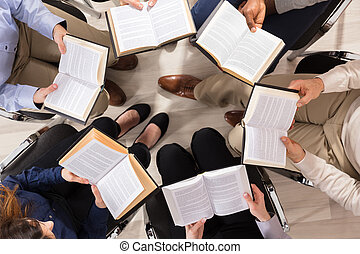 Group Of Diverse People Reading Books - Elevated View Of...