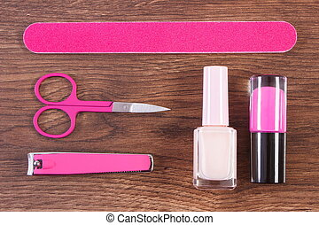 Cosmetics and accessories for manicure or pedicure on board,...