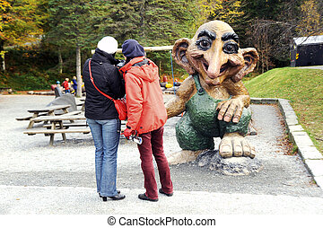 Photo for memory - Tourists take a photo of troll, Bergen,...