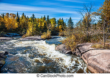 The old dam Pinava in autumn day - The old dam Pinava. Warm...