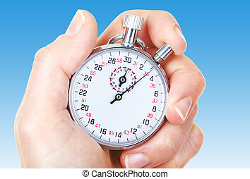 Mechanical stopwatch Over blue background