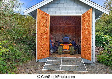 Little shed with tractor - Large home needs large equipment