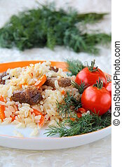 Eastern meal pilaf - traditional Oriental food pilaf - meat...