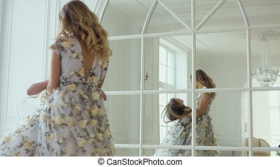 mom turns daughter's house around a large mirror