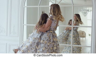 mom turns daughter's house around a large mirror and window...