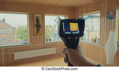 window heated, the readings of a thermal imager in house