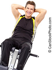 Work out - Smiling mature strong man working out. Isolated...