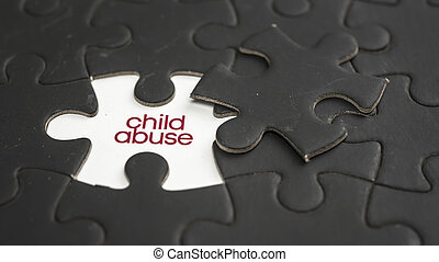 Child abuse - Words child abuse under jigsaw puzzle piece