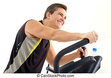 Smiling mature strong man working out Isolated over white...