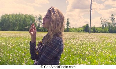 Young woman walking throught the meadow