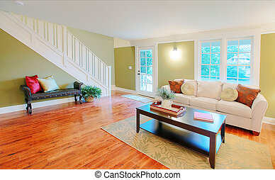 Living room with black coffee table - Well remodeled old...
