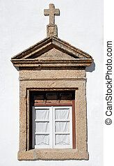old window in stone rural church, Portugal. - old small...