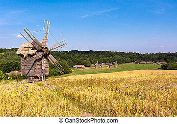 Old Windmill - Old wooden windmill in the countryside