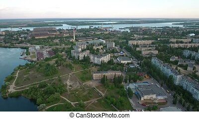 Aerial shot of the Dnipro river and Kherson city on its...