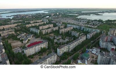 Aerial shot of Kherson apartment blocks built in rows and a...