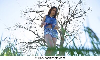 Sexy girl. Girl woman standing on in shorts nature sunlight...