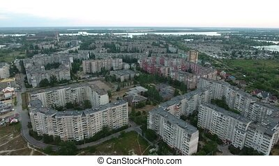 Aerial shot of round multistoreyed apartment blocks...