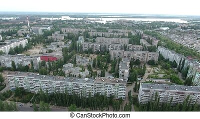 Bird`s eye shot of Kherson cityscape with its apartment...