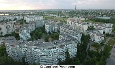 Aerial shot of Kherson city with its wide and long apartment...