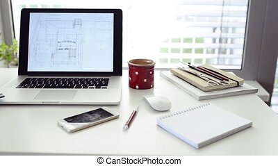 Home office. Desk with various gadgets y office objects. -...