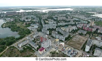Aerial shot of Kherson suburbs and the Dnipro river curvy...