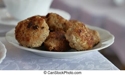 Homemade cutlets with oatmeal on a wooden table in rustic...