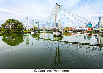 Gangaramaya public park, Colombo - Pedestrian bridge to...