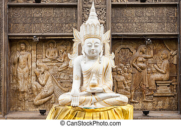 Gangaramaya Temple in Colombo - Buddha statue near...