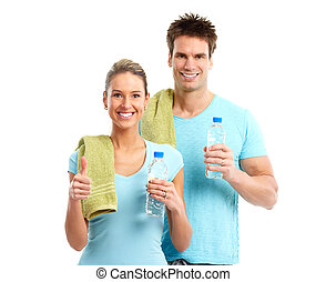 Fitness Smiling young strong man and woman Isolated over...