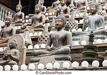 Gangaramaya Temple in Colombo - Buddha statues at...