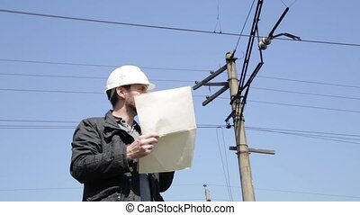 Engineer check electrical systems talk walkie-talkie,...