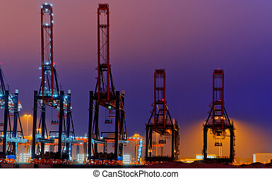 Quay Cranes - Container terminal scene in the Port of...