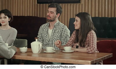 Freelance team members relaxing together in cafe....